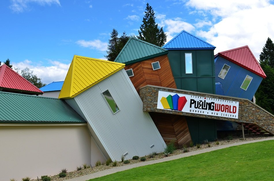 colorful leaning houses in row, modern architecture