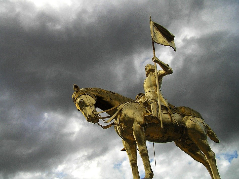Jeanne d'Arc equestrian sculpture at cloudy sky, france, caens