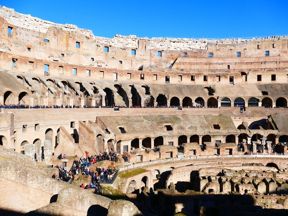 tourists in colosseum amphitheater, italy, rome