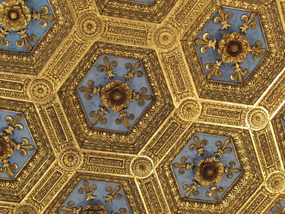 antique golden ornament on ceiling