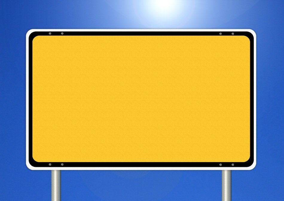empty yellow town sign