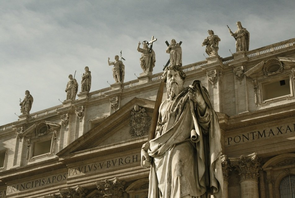 ancient statues on facade of St Peter's Basilica, italy, rome