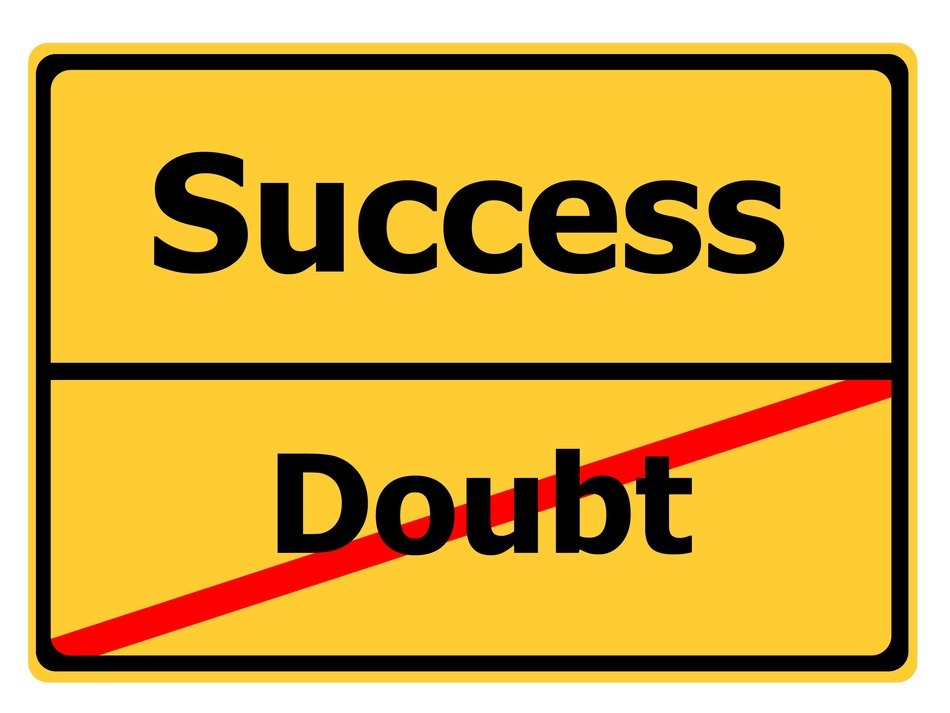 doubt success yellow road sign