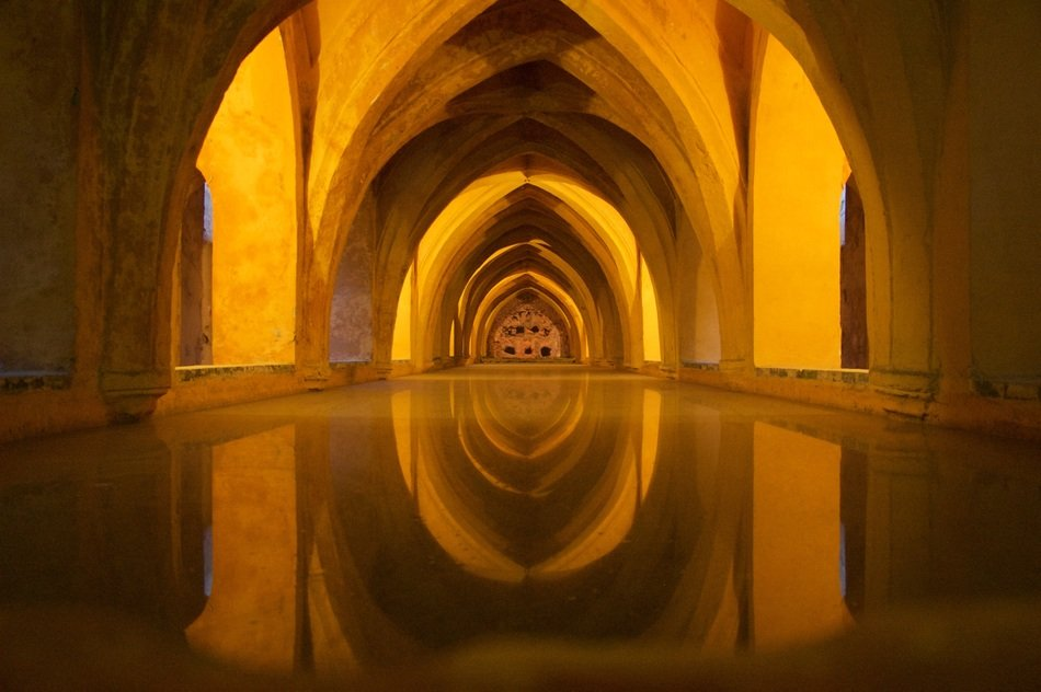 arched pathway in alcazar, royal palace, spain, andalusia, sevilla