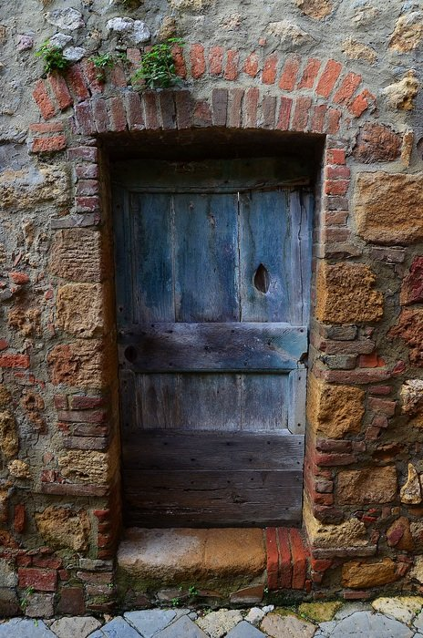 closed old door in stone wall