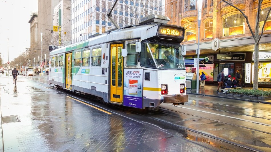 white tram in city at rainy weather, australia, melbourne