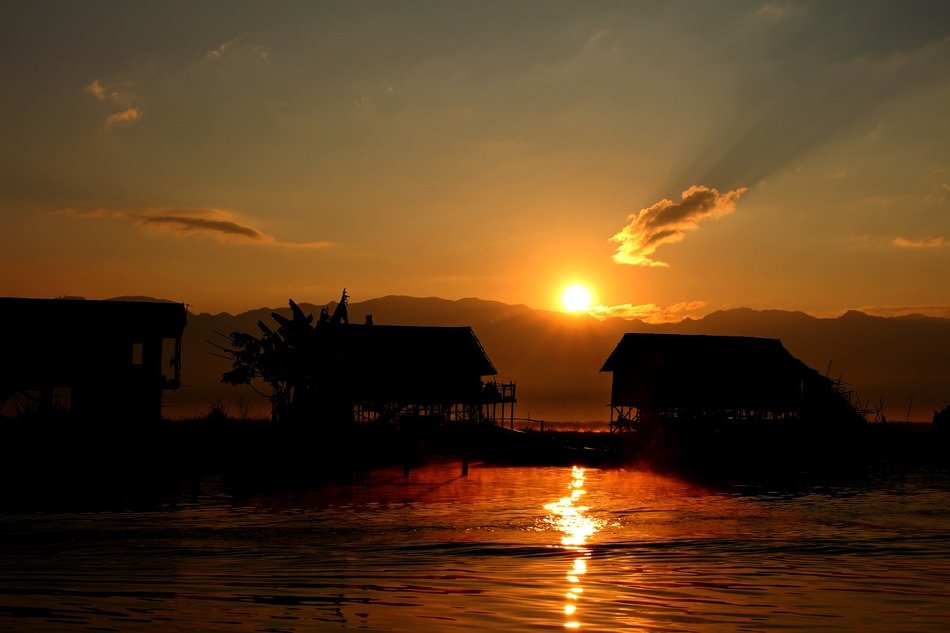 floating houses on inle lake at sunrise, myanmar