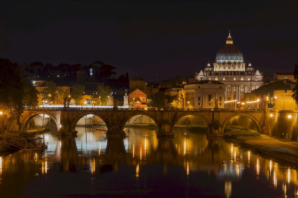 bridge, saint peters basilica and sant'angelo castle at nigh, italy, rome