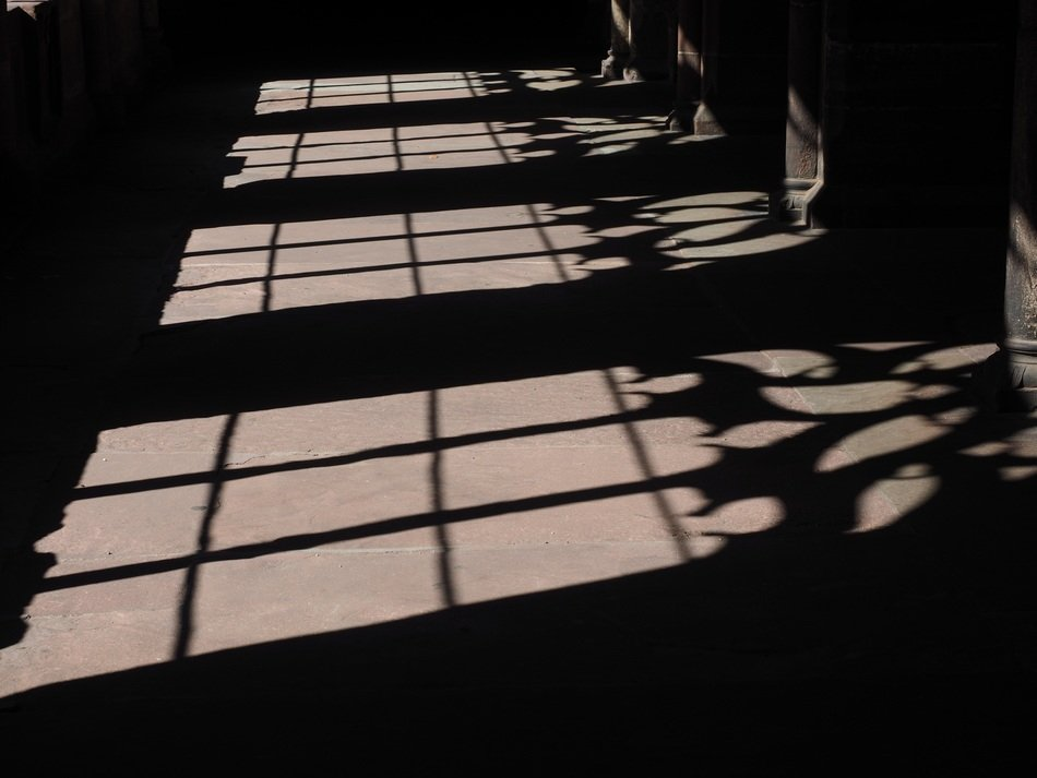 shadows from grates on stone floor