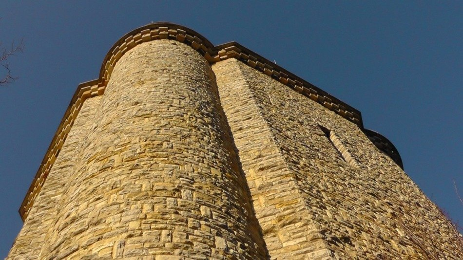 low angle view of high medieval tower at sky