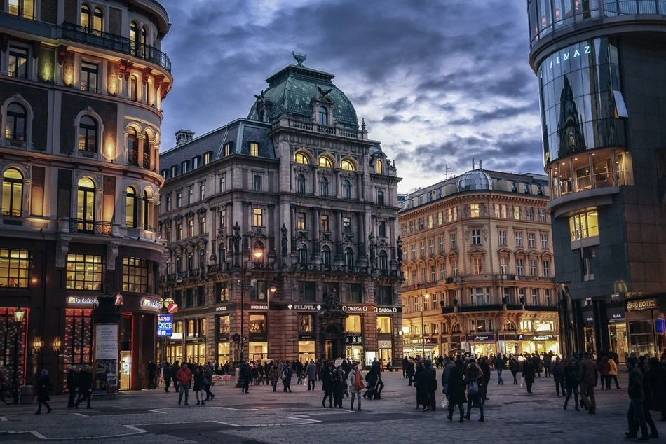 people in old city at evening, austria, vienna
