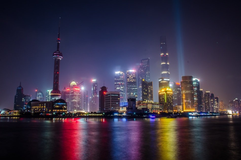 bright colorful lighting of nigth city with reflection on water, china, shanghai