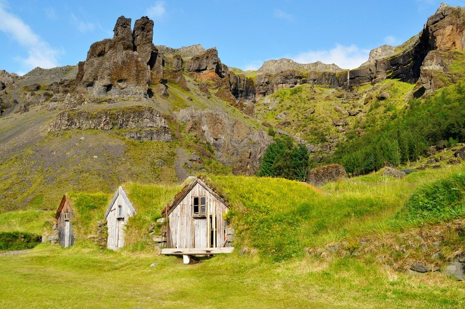 old wooden buildings at rocks, iceland