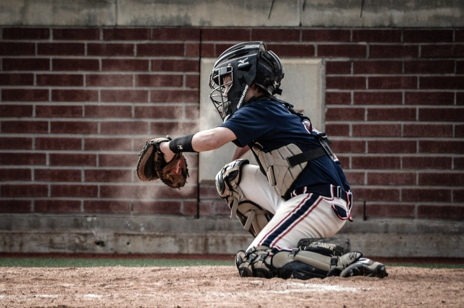 catcher, young baseball player in game