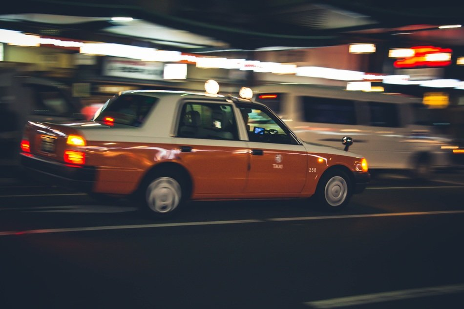 fast taxi cab on night street, japan, kyoto