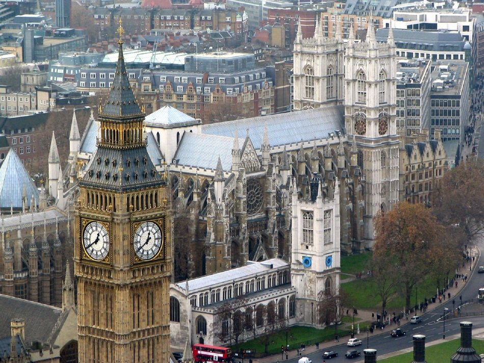 westminster abbey and big ben clock tower in cityscape, uk, england, london