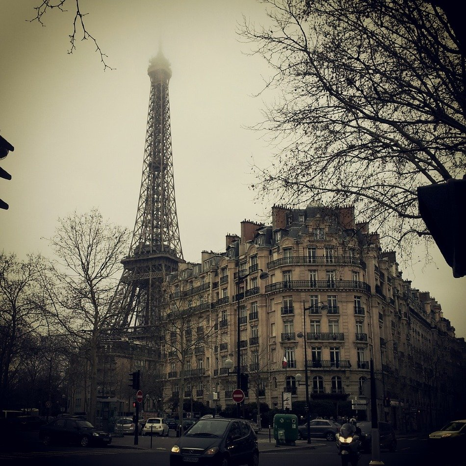 eiffel tower in foggy city, france, paris