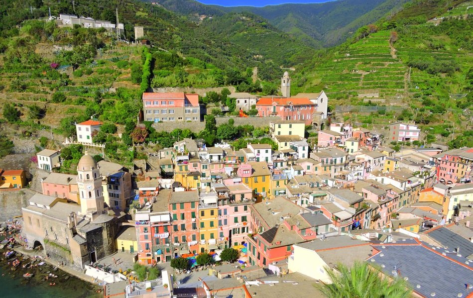 colorful houses at green mountains, italy, cinque terre, vernazza