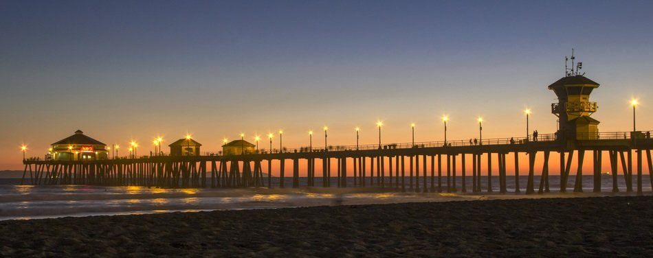 illuminated pier at dusk, usa, california, huntington beach