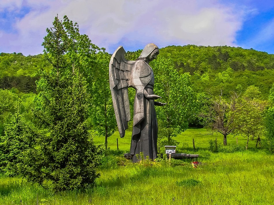 angel statue in green summer landscape