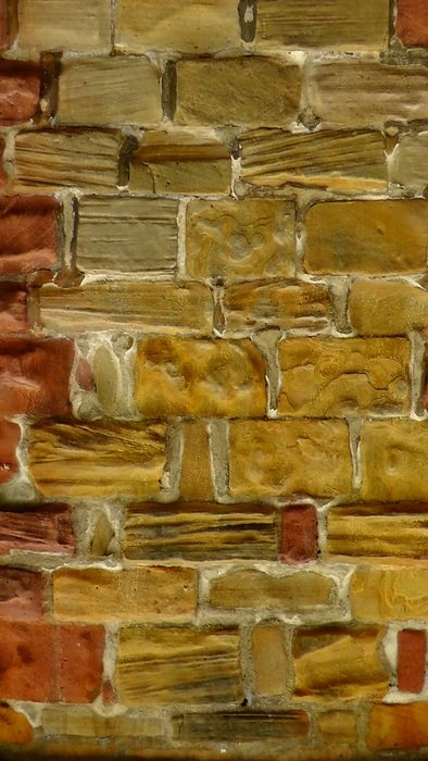 yellow and red stone blocks, surface of wall