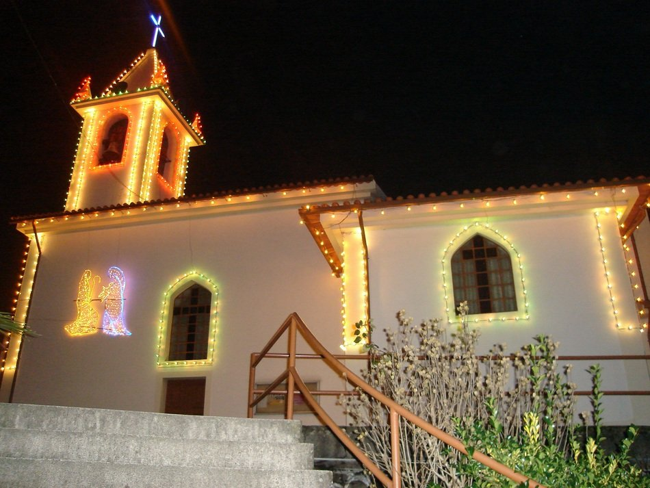 illuminated christmas decorations on church building