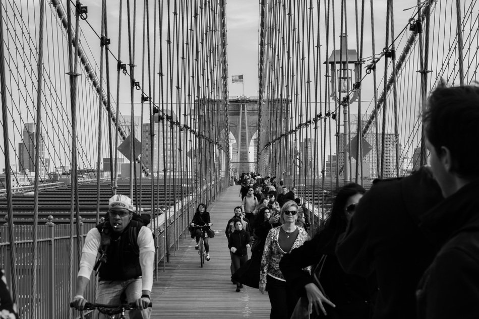 pedestrians on a suspension bridge