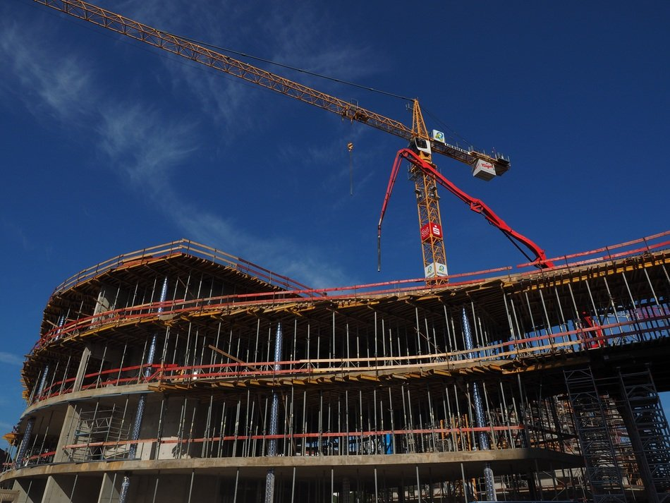 construction cranes and scaffolding at bridge-house, germany, new ulm