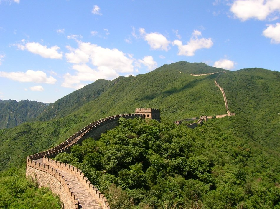 great wall of china in green mountain landscape