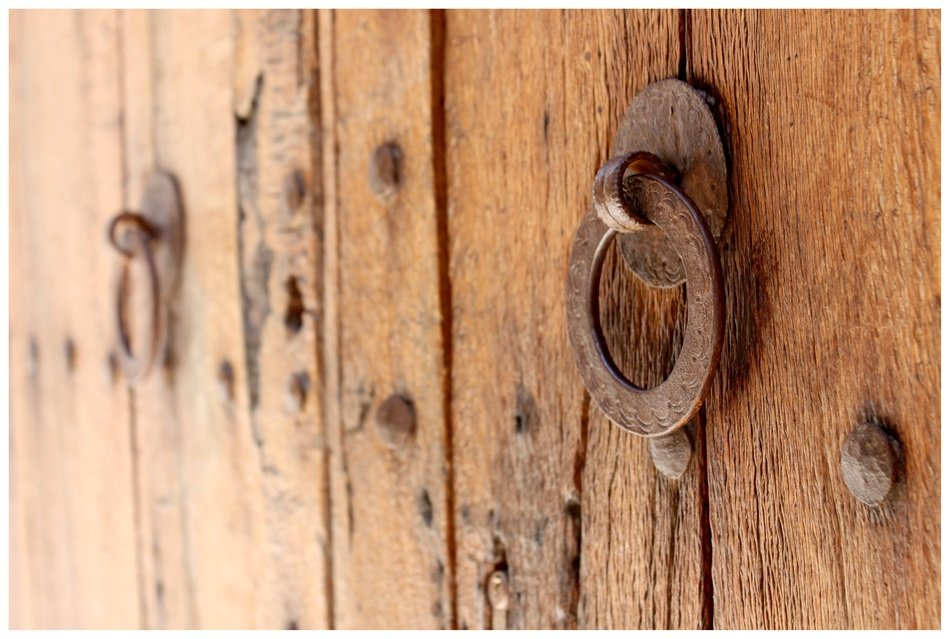 brass doorknocker on wooden door