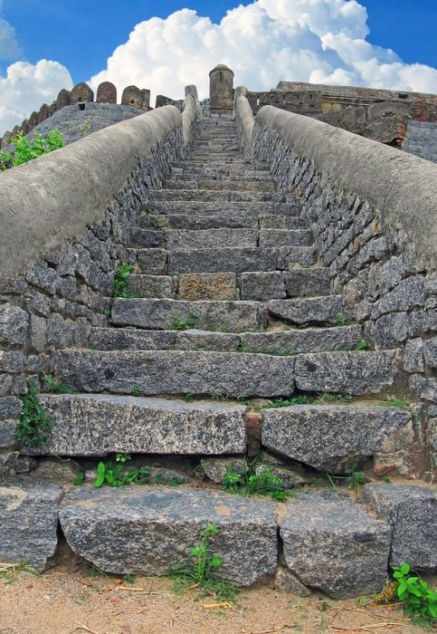 stone stairs to medieval fortress at sky, india