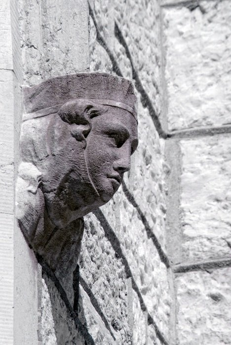 stone carved female head on wall