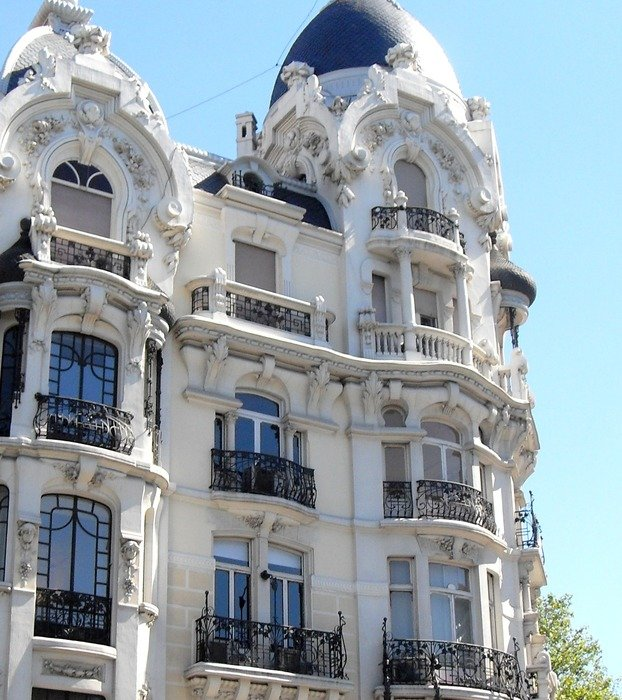 beautiful old facade with fenced balconies, spain, madrid