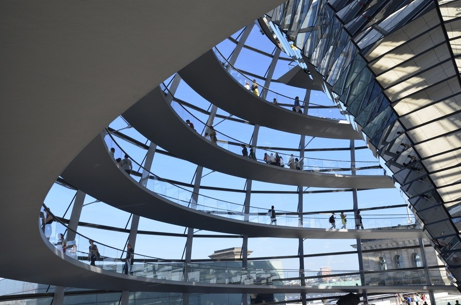 people in reichstag dome above city, germany, berlin