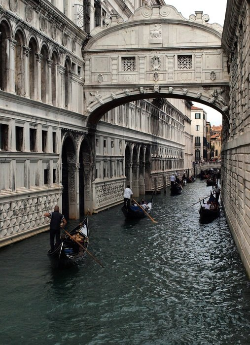 gondolas on channel in city, italy, venice