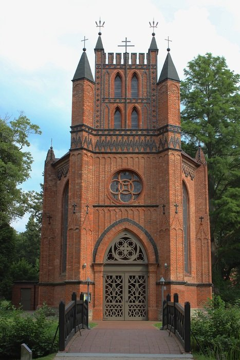 small gothic catholic church in park, germany, ludwigslust-parchim