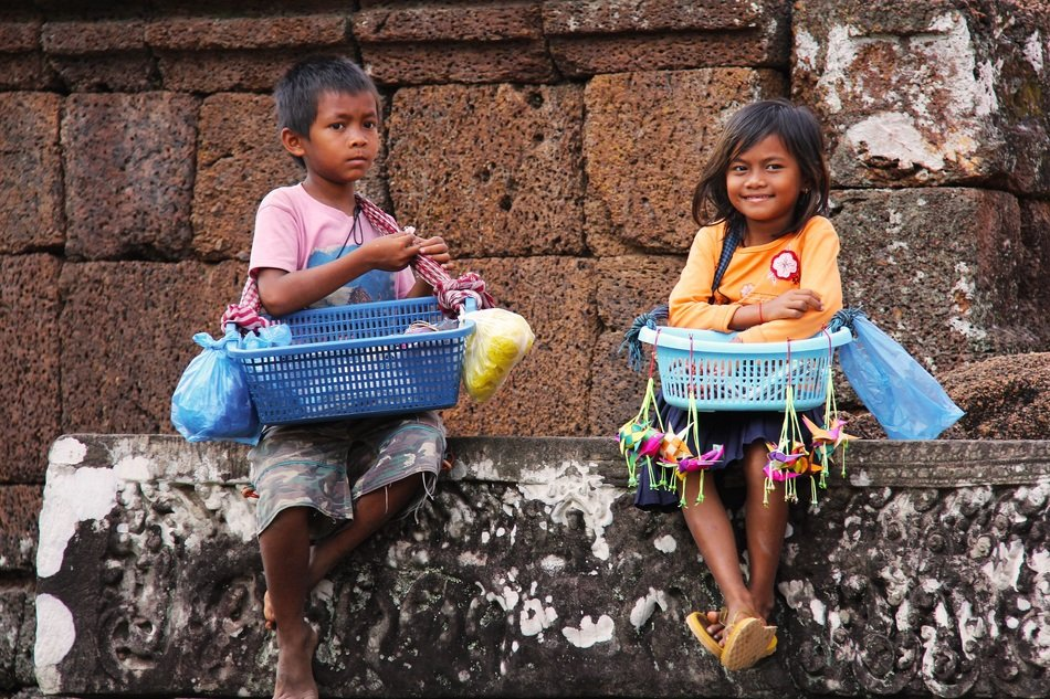 local children selling souvenirs