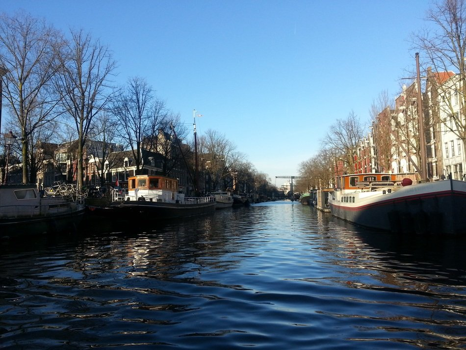 boats on gracht channel, amsterdam, netherlands