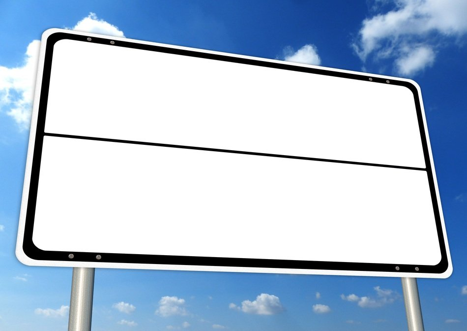 empty white signpost at sky