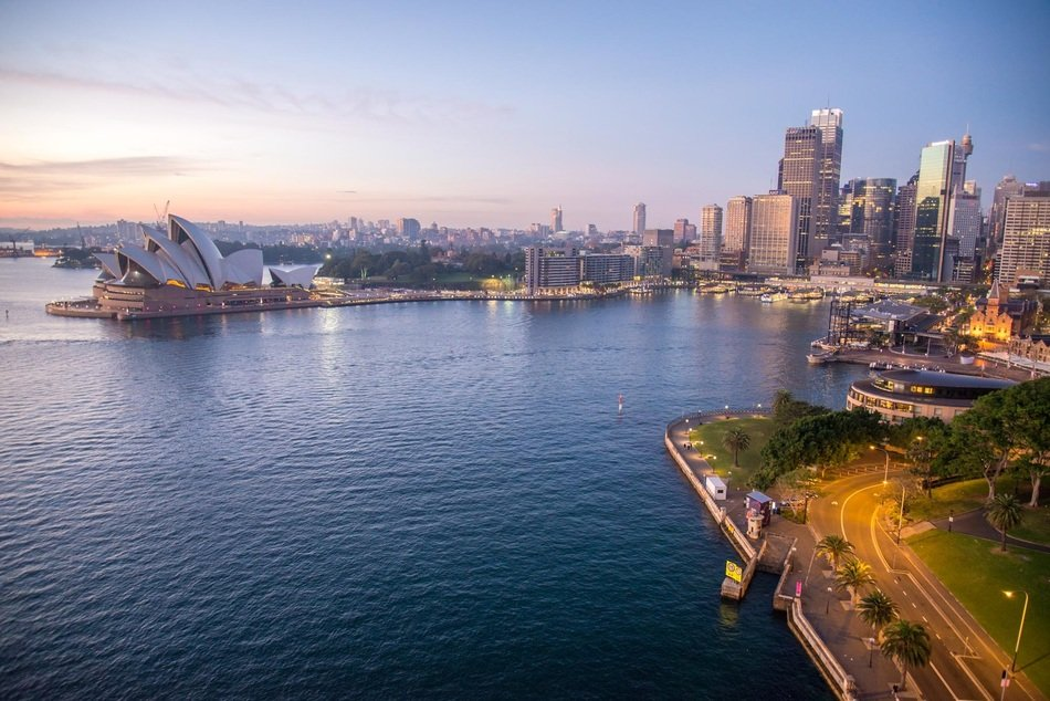 opera house in city skyline at evening, australia, sydney