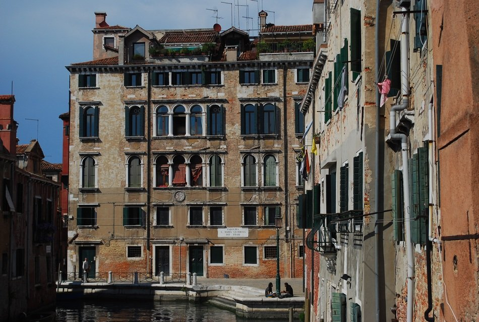 grunge old buildings at channel, italy, venice