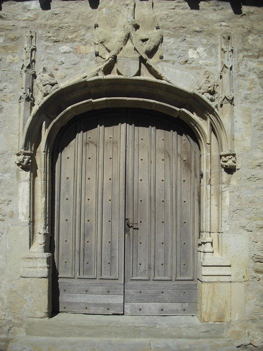 wooden door in medieval gateway
