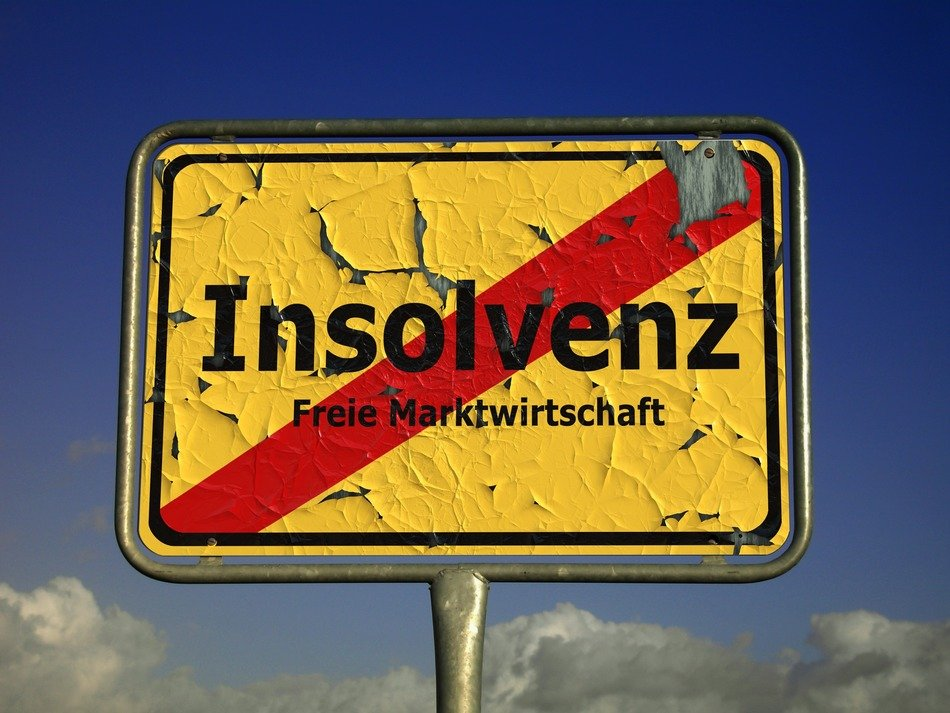Insolvenz(Insolvency) yellow town sign