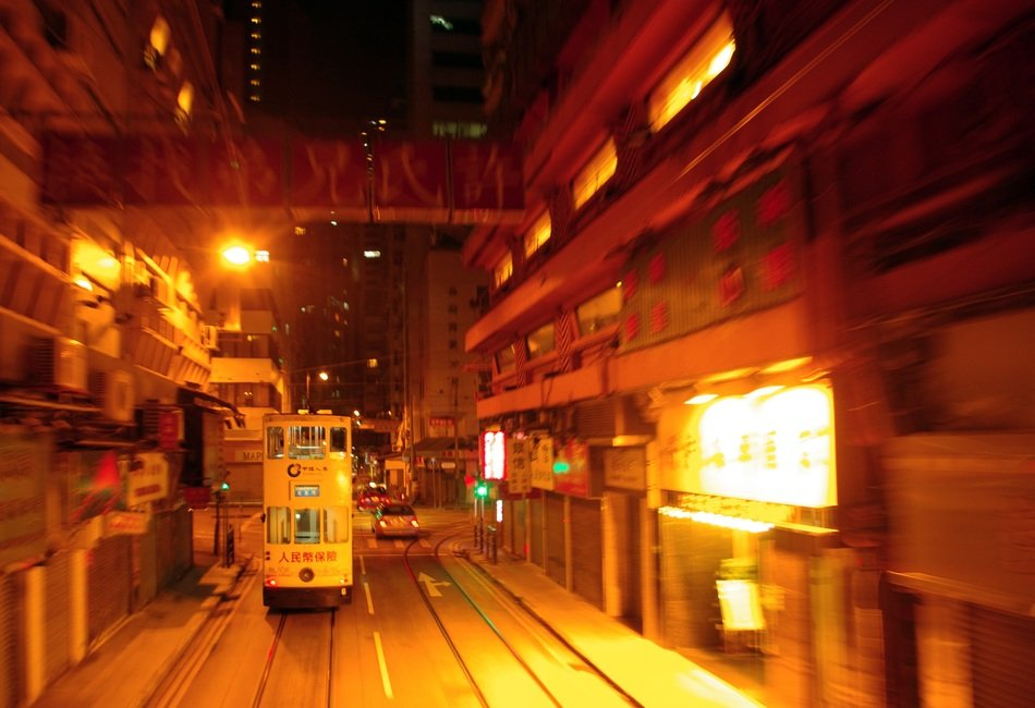 tram on street in night city, china, hong kong