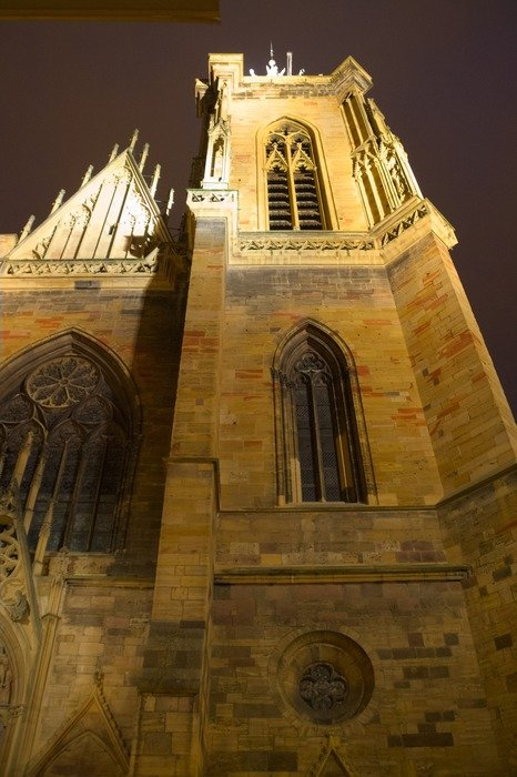 tower of gothic St Martin's Church at night, france, alsace, colmar