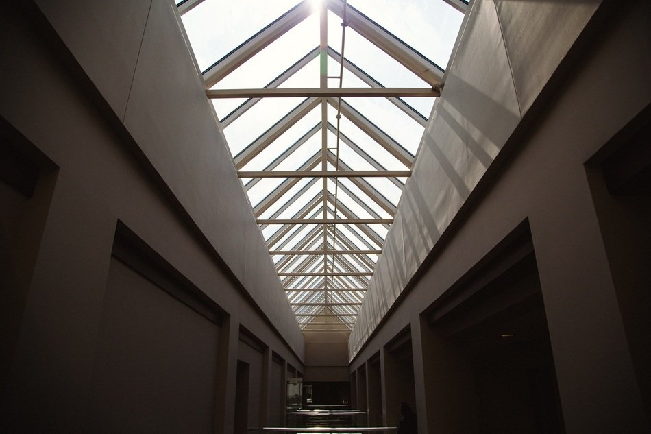 hallway with skylight ceiling in building