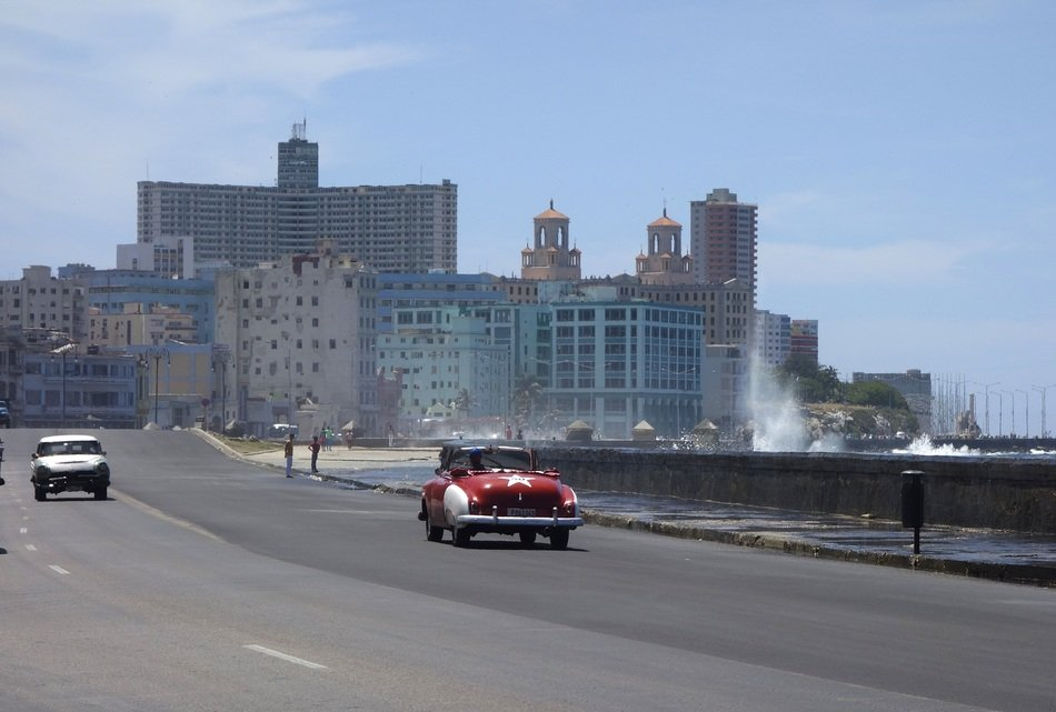 sea surf wave splash at road in city, cuba, havana