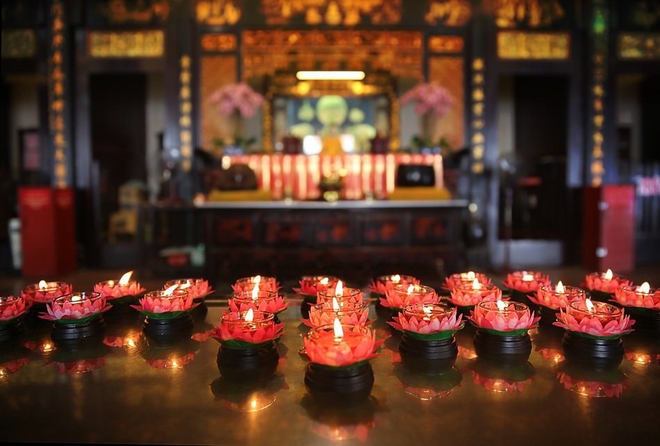 burning red candles in temple, china