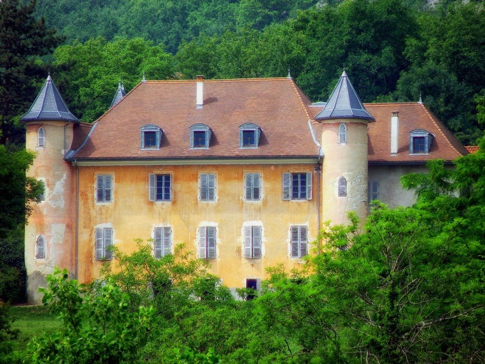 chateau de bornes, medieval castle in summer forest, france