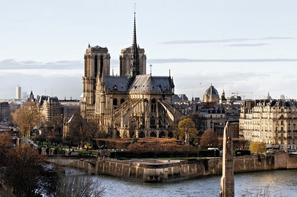 notre dame of paris cathedral at autumn, view from the seine river, france